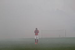 Football match stopped because of smoke from fireworks Royalty Free Stock Images