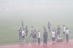 Football match stopped because of smoke from fireworks Stock Photo