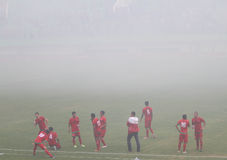 Football match stopped because of smoke from fireworks Royalty Free Stock Photo