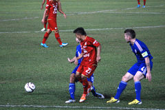 The football match between Thailand and Finland in the 42nd King's cup. Stock Photos