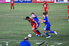 The football match between Thailand and Finland in the 42nd King's cup. Stock Photo