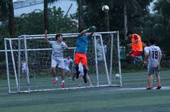 Football match - goal keeper face to face with the ball at Hanoi, Viet nam - July, 29,2018. This is a football match between two teams in one company stock photo