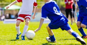 Football match for young players. Training and football soccer t stock photos
