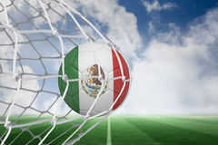 Football in mexico colours at back of net Stock Photos