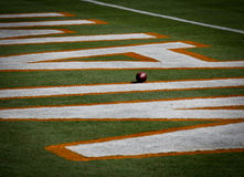 Football in Miami Dolphin's End Zone Royalty Free Stock Photography