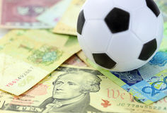 Football and money soccer betty Royalty Free Stock Photo