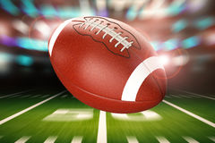 Football in motion. 3d rendering american football ball with motion background Royalty Free Stock Photography