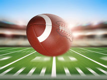 Football in motion. 3d rendering american football ball with motion background Stock Photography