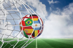 Football in multi national colours at back of net Stock Photography