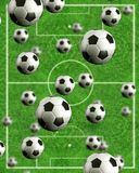 Football multiball - field in the background Royalty Free Stock Images