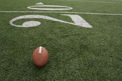 Football near the Twenty. Yard line on a artificial turf field Royalty Free Stock Image