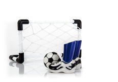 Football Net with boots and ball Stock Photo