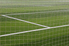 Football net and field Stock Images
