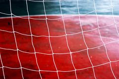 Football net  Siemens background. Football net and field football.Red Siemens and net on gate football Royalty Free Stock Images