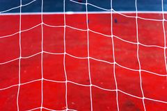 Football net  Siemens background. Football net and field football.Red Siemens and net on gate football Royalty Free Stock Photography