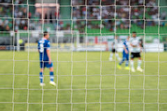 Football net during a football mach. Focus on the net Royalty Free Stock Photo