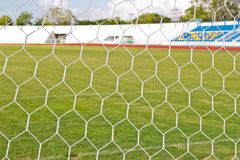 Football net on green grass background Royalty Free Stock Photography