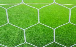 Football net on green grass Royalty Free Stock Photo