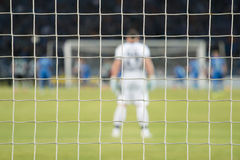Football net during a mach. Focus on the net Stock Image