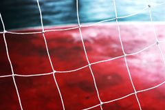 Football net  Siemens background. Football net and field football.Red Siemens and net on gate football Royalty Free Stock Image