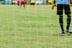 Football nets lacking. Net of the football field soccer green grass goal lack mesh damaged Football goal is damaged Stock Photo