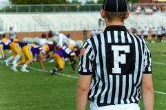 Football Official. With black and white striped jersey, symbol is for field judge, at an american football game Royalty Free Stock Images