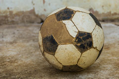 Football. On the old concrete floor.street foootball Royalty Free Stock Images