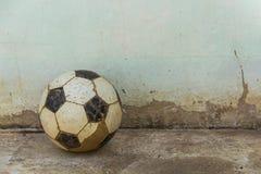 Football. On the old concrete floor.street foootball Stock Image