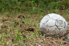 Football. Old football on grass field Royalty Free Stock Photography