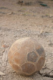 Football. The old football on the grunge floor Royalty Free Stock Image