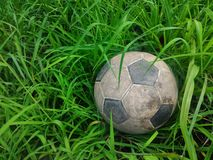 Football. Old football on the lawn Royalty Free Stock Images