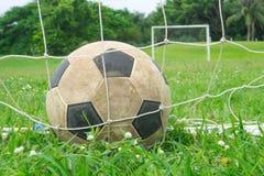 Football. Old leather football on green field stock photos