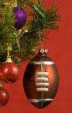 Football Ornament Hanging On Christmas Tree Royalty Free Stock Images
