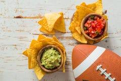 Football party food, super bowl day, nachos salsa guacamole. Copy space stock photos