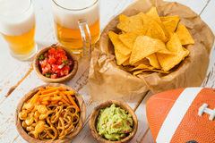 Football party food, super bowl day, nachos salsa guacamole. Copy space stock photos