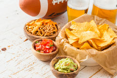 Football party food, super bowl day, nachos salsa guacamole Stock Image