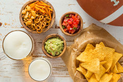 Football party food, super bowl day, nachos salsa guacamole Royalty Free Stock Image