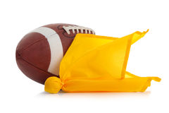 Football and penalty flag on white. Football and yellow penalty flag on a white background Stock Image