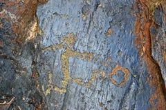 Football petroglyph. A man plays soccer. Petroglyph in Kyrgyzstan Royalty Free Stock Photos