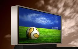 Football picture on monitor. Soccer ball on green grass on monitor and blue sky royalty free stock image