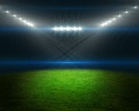 Football pitch with bright lights Stock Photo
