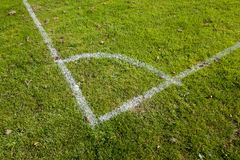 Football Pitch Corner Markings. Close-up of the corner markings on a grassy football pitch Royalty Free Stock Photo
