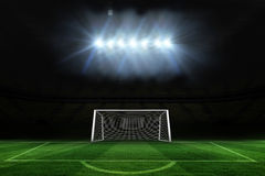 Football pitch and goal under spotlights Stock Images