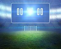 Football pitch with goalpost and scoreboard Stock Photography