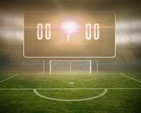 Football pitch with goalpost and scoreboard Stock Photos