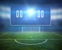 Football pitch with goalpost and scoreboard Royalty Free Stock Photography