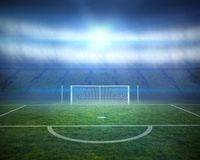 Football pitch with goalpost in stadium Royalty Free Stock Image