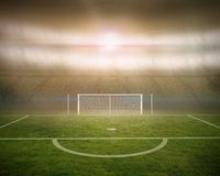 Football pitch with goalpost in stadium Royalty Free Stock Photo