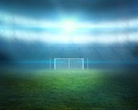 Football pitch with lights and goalpost Stock Photography