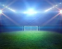 Football pitch with lights and goalpost Stock Photos